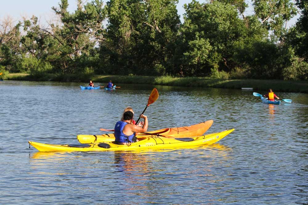 Kayakers and pond